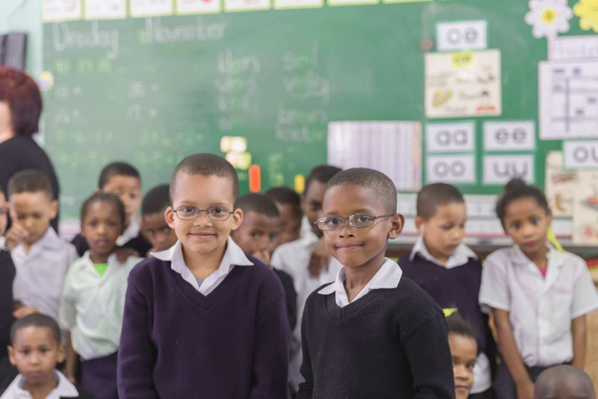 Kids wearing glasses in classroom