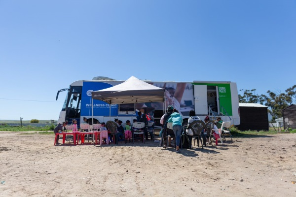 Mobile clinic visiting a school to deliver a service
